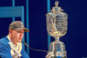 FARMINGDALE, NEW YORK - MAY 19: Brooks Koepka of the United States sits alongside the Wanamaker Trophy as he speaks to the media during a press conference after winning during the final round of the 2019 PGA Championship at the Bethpage Black course on May 19, 2019 in Farmingdale, New York. (Photo by Jamie Squire/Getty Images)