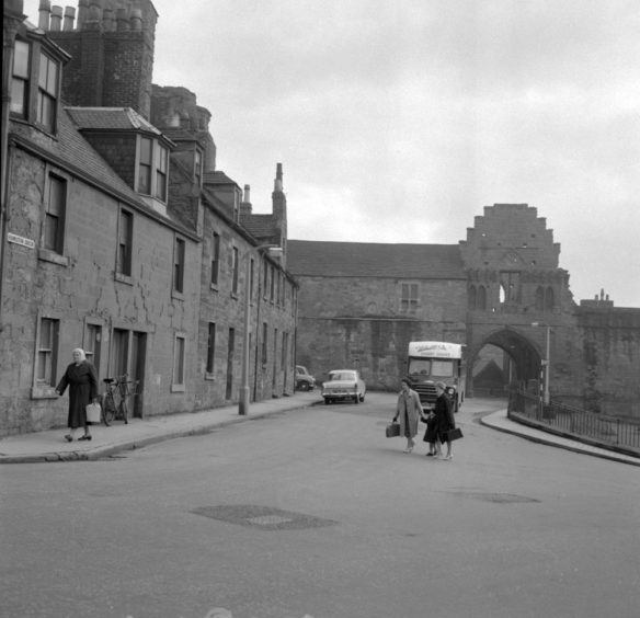 Looking towards the Abbey Port and the Gatehouse range. The last two of the houses in the foreground were to be demolished despite a fight to save them led by Councillor Frank Thornton. 1963.
