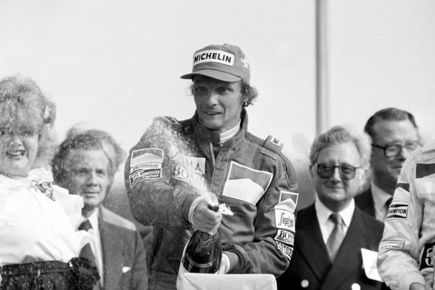 """ustrian Niki Lauda celebrating victory in the British Grand Prix at Brands Hatch after winning in his Marlboro McLaren. Formula 1 racing team McLaren said it was """"deeply saddened"""" to learn that three-time world champion driver Niki Lauda had died aged 70."""