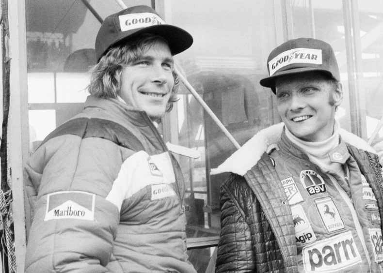 1976, file photo, Austrian auto racer Niki Lauda, right, defending champion in world driving, and James Hunt, of Britain, look at the rain before the start of the Japan Grand Prix Formula One auto race at Fuji International Speedway, Gotemba, Japan. Three-time Formula One world champion Niki Lauda, who won two of his titles after a horrific crash that left him with serious burns and went on to become a prominent figure in the aviation industry, has died. He was 70.
