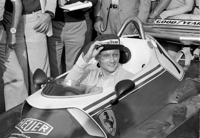 In this Sept. 7, 1976 file photo Austria's Niki Lauda behind the wheel of his Ferrari 312 T2 on the track of Florano after a near fatal crash on Aug. 1 during the German Grand Prix. Three-time Formula One world champion Niki Lauda, who won two of his titles after a horrific crash that left him with serious burns and went on to become a prominent figure in the aviation industry.