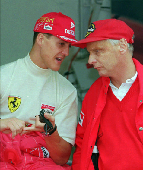 1996 file photo defending champion Michael Schumacher of Germany, left, chats with Ferrari consultant Niki Lauda during the practice session for the Monaco F1 Grand Prix in the principality.