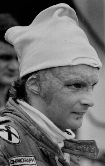 1977 file photo Austria's Niki Lauda, driving for Ferrari during a pit stop at the Grand Prix of Brazil.