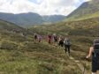 A group of walkers enjoying the tranquil peace of the Angus Glens during one of the walks.