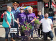 Jean Stewart, Ian Angus, Amanda McNairn, Debbie Warren, Rhys McNairn and Jim McNairn unveil the bike.