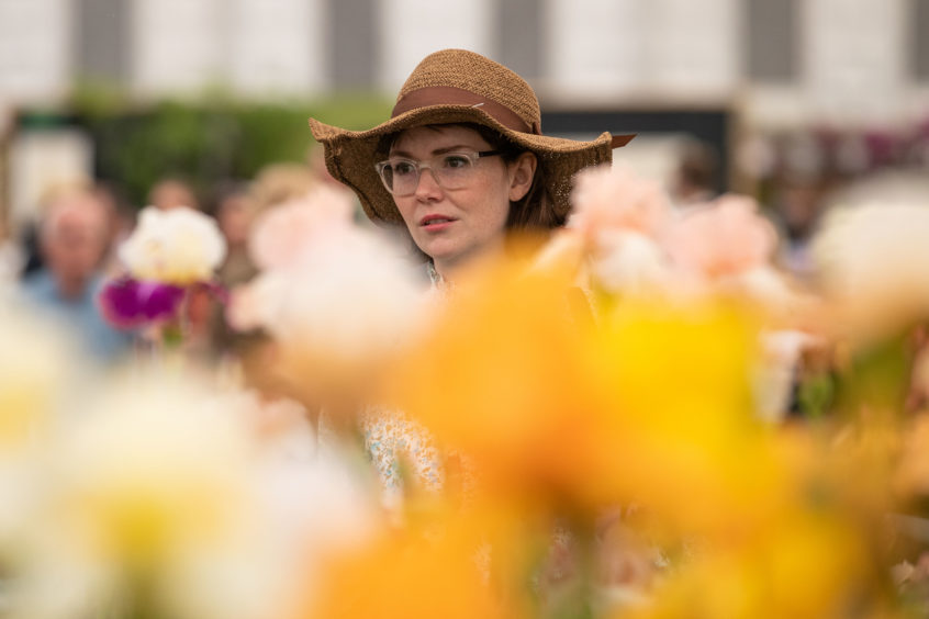 A visitor views flowers as the doors open to the public at the RHS Chelsea Flower Show at the Royal Hospital Chelsea, London.