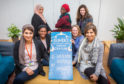 Fatima Ramzan, Mariam Diallo, Susan A'Brook and Vaqar Salimi. Back row, left to right is Nausheen Karim, Diare Drammeh and Beth Morgan at Dundee Internal Women's Centre