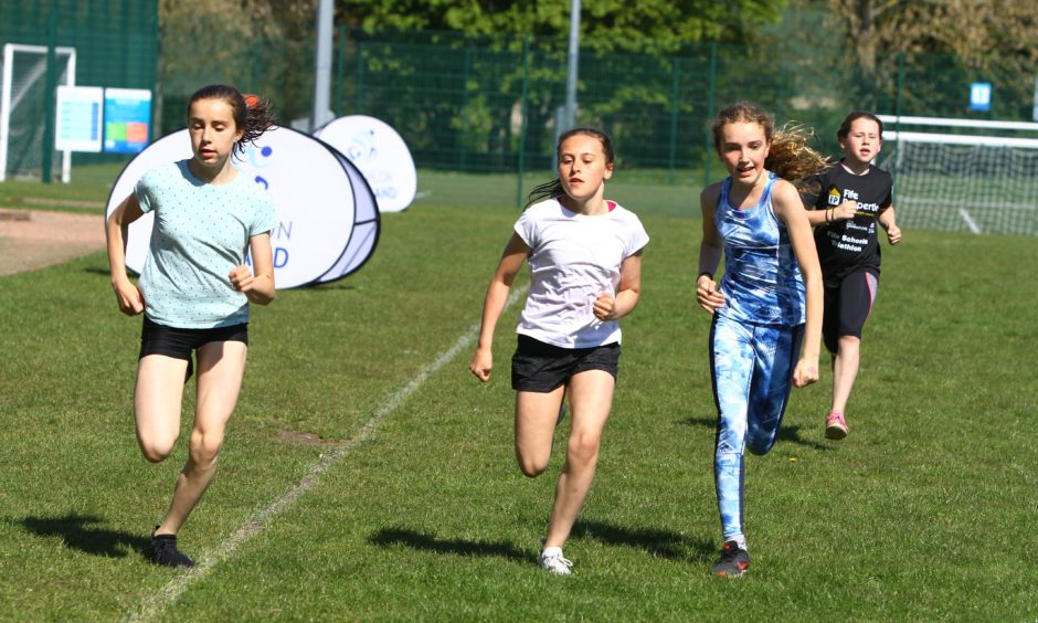 Pupils make a dash for the finish line.