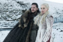 "Kit Harington as Jon Snow, left, and Emilia Clarke as Daenerys Targaryen in a scene from ""Game of Thrones""."