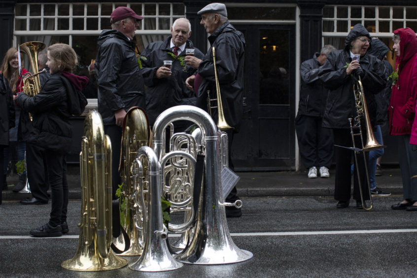 Brass instruments are left on the ground as the band enjoy a drink at one the the towns pubs.