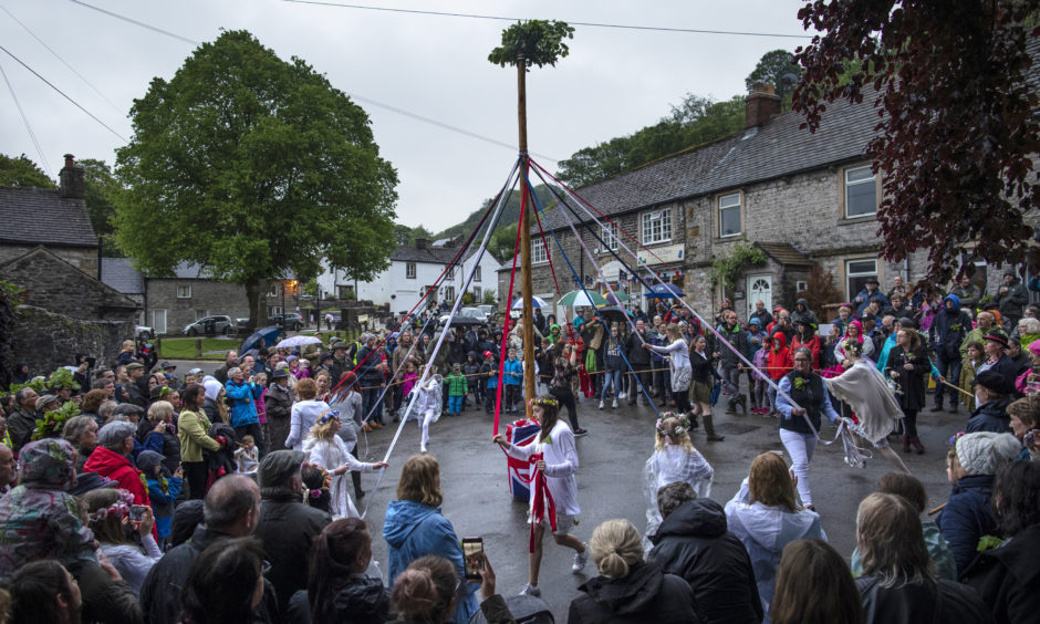 Dancers around the Maypole during 'Castleton Garland Day' on May 29, 2019 in Castleton, England.