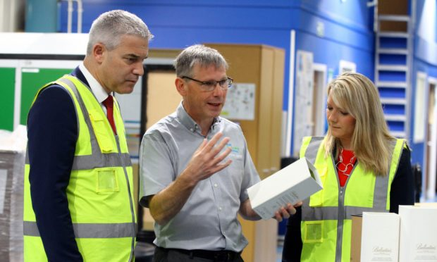 Brexit secretary Steve Barclay chatting to  Steve Larter and MP Kirstene Hair. Picture: Gareth Jennings