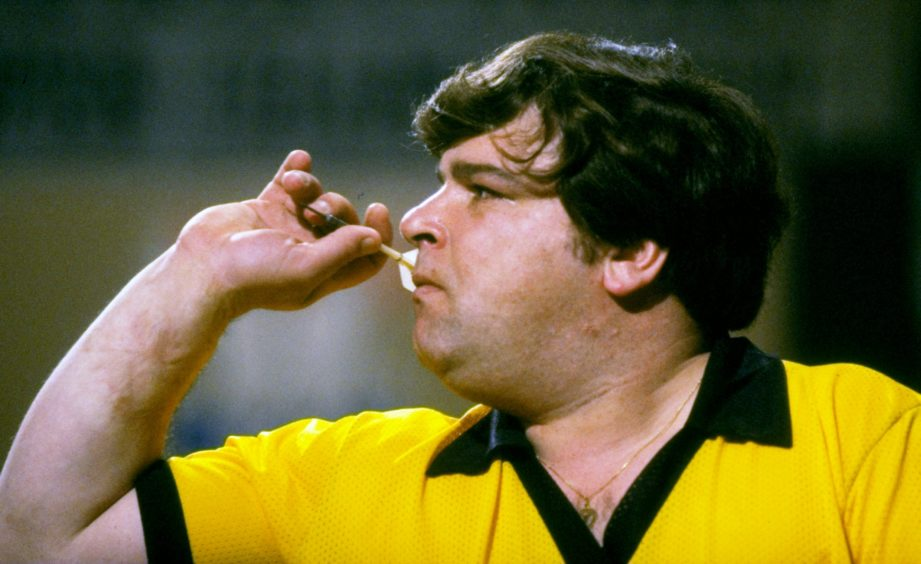 Jocky Wilson prepares to throw a dart during the 1984 British Open