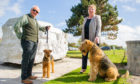 Airedale statue in East Haven. Picture Shows; l to r - Jim Collins with Penny and Wendy Turner with Cooper, East Haven Car Park, East Haven, 16th May  2019. Pic by Kim Cessford / DCT Media