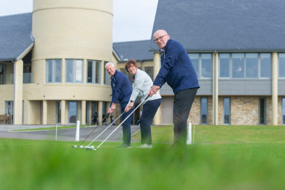 Donald Archibald, Community Benefits Administrator, Pat Sawers, Chairman of Carnoustie Golf Links and David Cheape, Community Benefits Convenor tee up the announcement