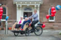 Residents, Ethel Candy and Sheila Banister and deputy manager, Lavine McMaster with the new trishaw.