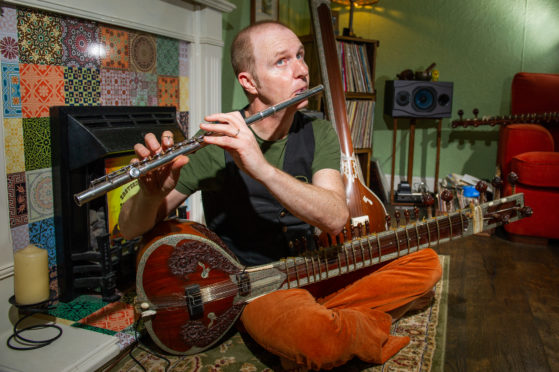 Dundee musician relieved to see return of 'irreplaceable' instrument - The Courier