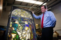 Geoffrey Taylor views the stained glass window