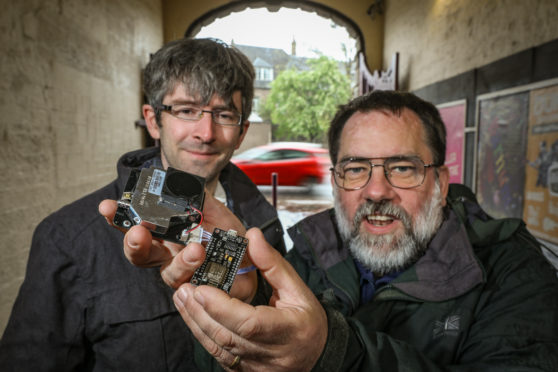 Dr Peter Cock, left, and Dr David Martin with a pollution sensor