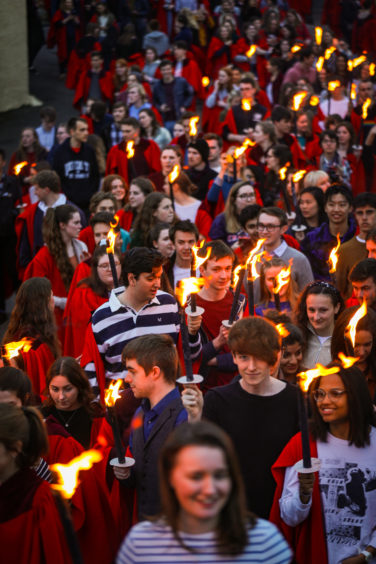 University of St Andrews students taking part in the Gaudie torchlight procession.