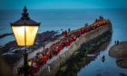 The annual Gaudie pier walk takes place in St Andrews, commemorating the selfless actions of one of one of the town's greatest figures John Honey who saved five fishermen. The spectacular torchlight procession sees students in their red gown walk along the historic pier.