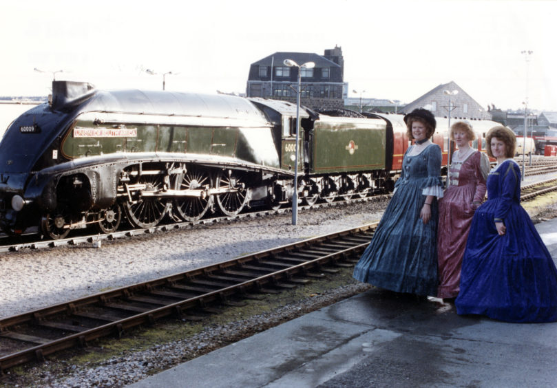 Joan Sinclair, Susan Thomson and Lorraine Ogg, with the A4 Pacific steam engine, as the Union of South Africa sits behind.