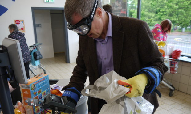 Shopping became a real challenge for Willie Rennie MSP wearing an MS kit.