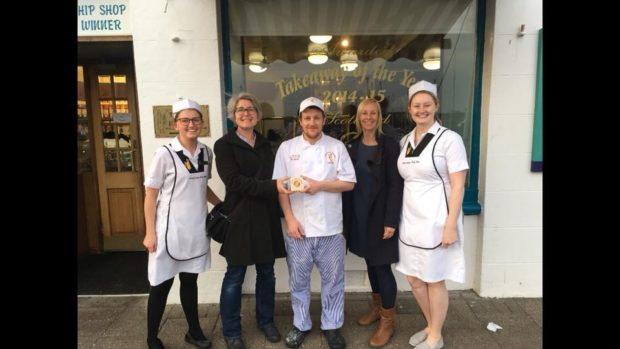 Anstruther Fish Bar employees were presented with a plaque by Alice Pearson and Helen Patterson, of Plastic Free Anstruther