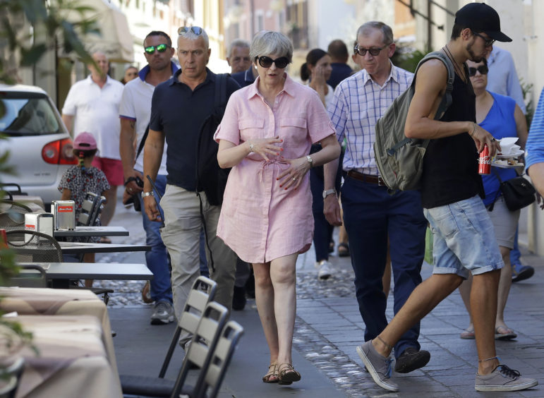 File photo dated 25/07/18 of Prime Minister Theresa May and her husband Philip visit Desenzano del Garda, near Lake Garda in northern Italy, during their summer holiday. The Prime Minister is expected to announce details later today of her timetable for leaving Downing Street.