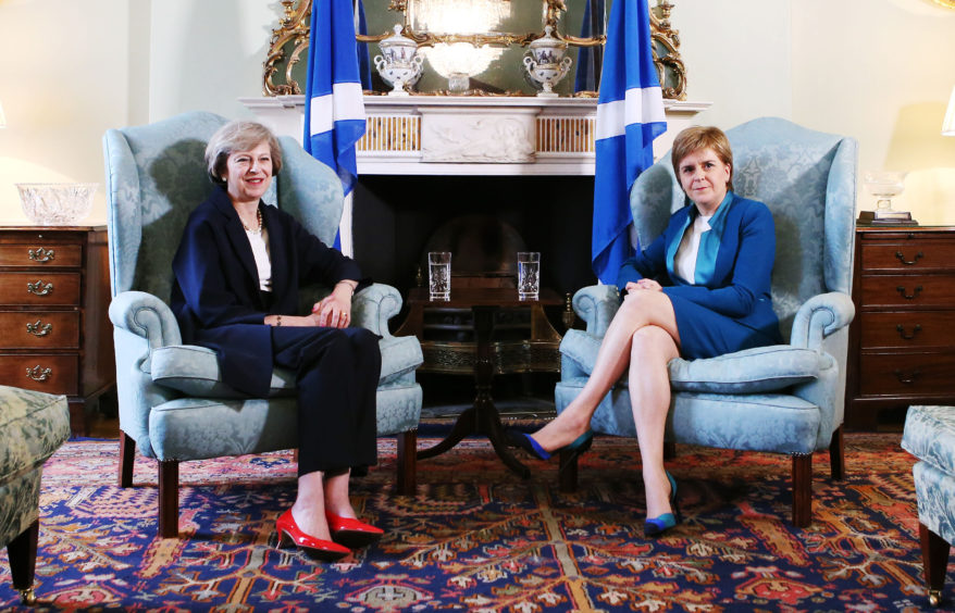 File photo dated 15/07/16 of Prime Minister Theresa May (left) meeting with Scotland's First Minister Nicola Sturgeon at Bute House in Edinburgh. The Prime Minister is expected to announce details later today of her timetable for leaving Downing Street.