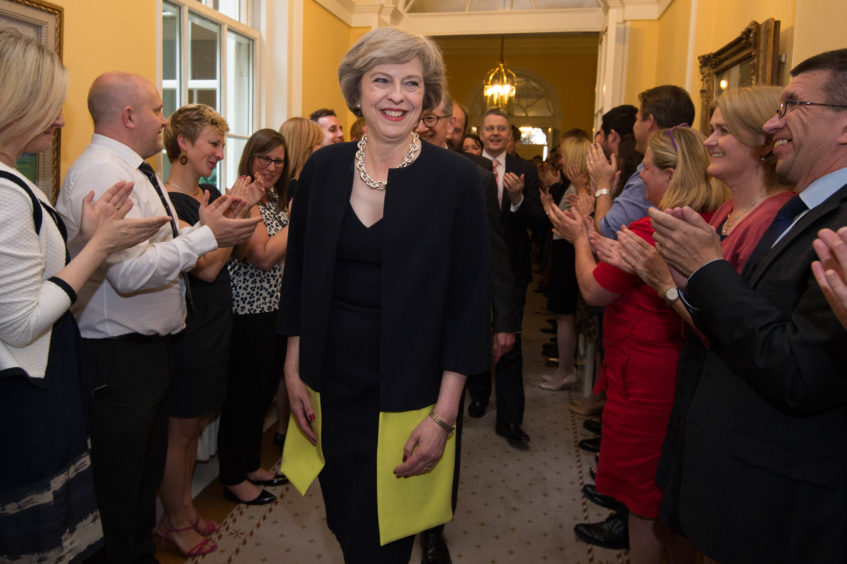 16 of staff clapping as Prime Minister Theresa May, followed by her husband Philip John, arrives at 10 Downing Street, London, after meeting Queen Elizabeth II and accepting her invitation to become Prime Minister and form a new government. The Prime Minister is expected to announce details later today of her timetable for leaving Downing Street.