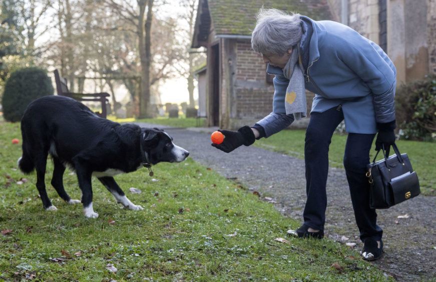File photo dated 17/02/19 of Prime Minister Theresa May throwing a ball for a Border Collie called Blitz as she leaves after attending a church service near her Maidenhead constituency. The Prime Minister is expected to announce details later today of her timetable for leaving Downing Street.