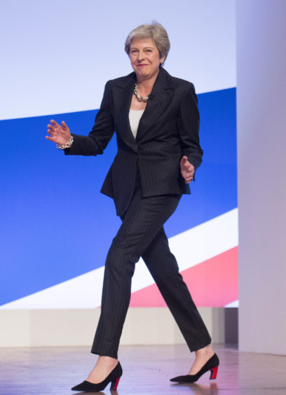 File photo dated 03/10/18 of Prime Minister Theresa May danceing as she arrives on stage to make her keynote speech at the Conservative Party annual conference. The Prime Minister is expected to announce details later today of her timetable for leaving Downing Street.