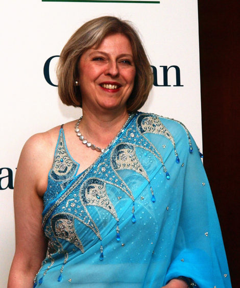 File photo dated 19/05/2010 of the then Home Secretary Theresa May arriving for the Asian Women of Achievement Awards at London Hilton, London. The Prime Minister is expected to announce details later today of her timetable for leaving Downing Street.