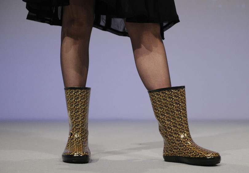 File photo of the then Shadow Leader of House of Commons Theresa May addresses the Conservative Party conference in Blackpool wearing wellington boots. The Prime Minister is expected to announce details later today of her timetable for leaving Downing Street.