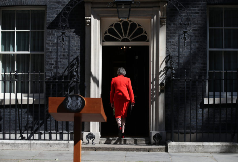 Prime Minister Theresa May leaves after making a statement outside at 10 Downing Street in London, where she announced she is standing down as Tory party leader