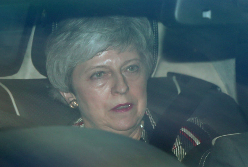 """Prime Minister Theresa May leaves the House of Commons in London as Shadow Brexit secretary Sir Keir Starmer warned it was """"impossible"""" to see how an agreement between the Conservatives and his party could clear the Commons unless it guaranteed the deal would be put back to the public for a """"confirmatory vote""""."""