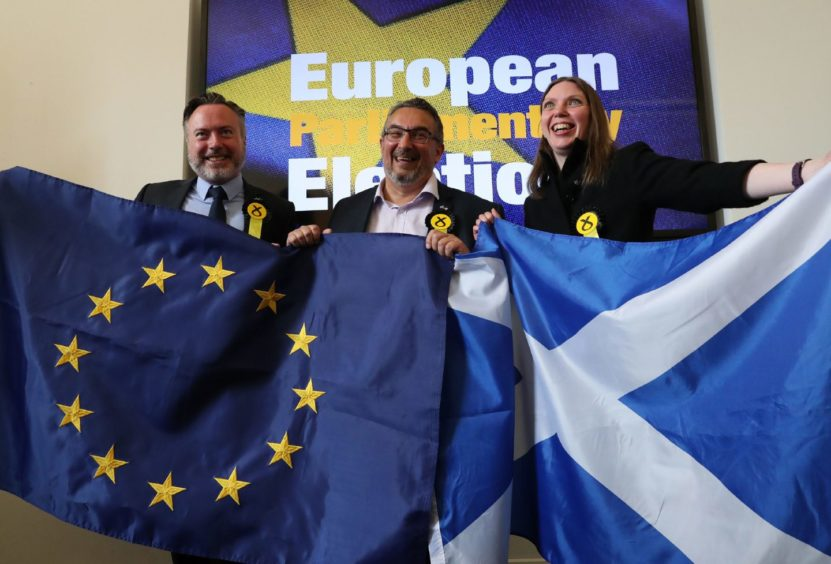 Newly elected SNP MEPs, from left, Alyn Smith, Christian Allard and Aileen McLeod at the European Parliamentary elections count at the City Chambers in Edinburgh.