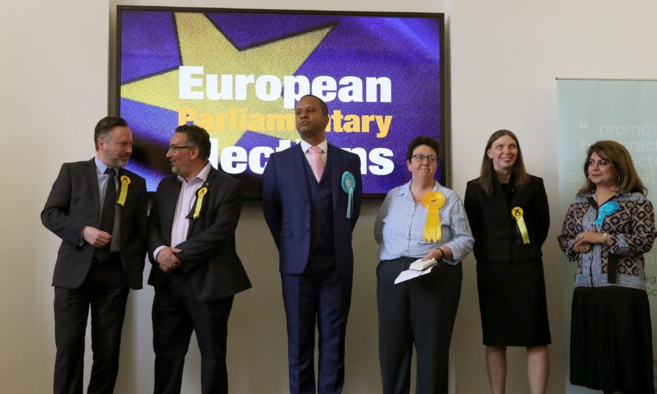 Newly elected MEPs, from left, Alyn Smith, Christian Allard, Aileen McLeod, Louis Stedman-Bryce, Sheila Ritchie and Nosheena Mobarik at the European Parliamentary elections count at the City Chambers in Edinburgh.