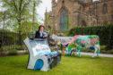 Geraldine McCaughrean alongside her bench.