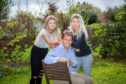 Gordon Walker and his two daughter's Romy and Mara.