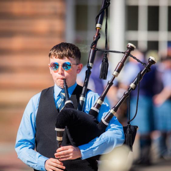 Lochgelly High School Pipe Band warm up.