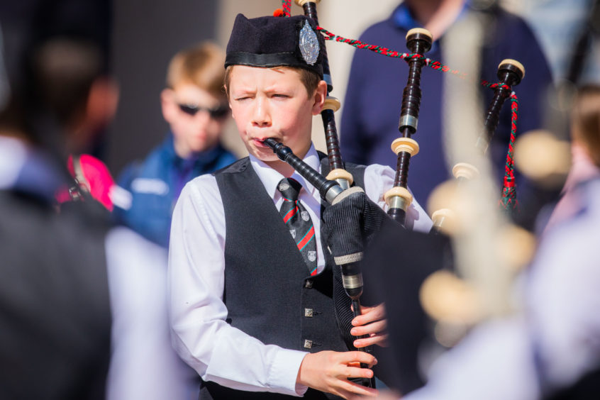 Dundee city centre rang out with the sound of bagpipes on Sunday. Dollar Academy NJ B Pipe Band.