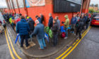 Dundee United fans queue for tickets to the play-off final.