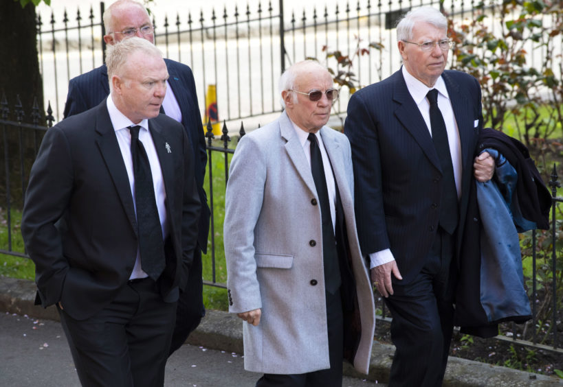 Scotland manager Alex McLeish (left) arrives at the funeral of Celtic's legendary European Cup winning captain Billy McNeill alongside former Rangers player Willie Henderson