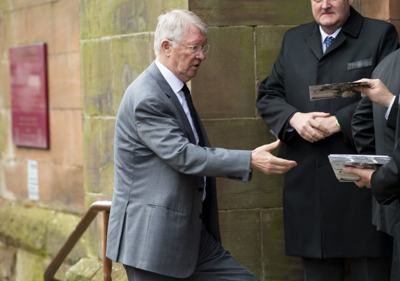Former Manchester United manager Sir Alex Ferguson arrives at the funeral of Celtic's legendary European Cup winning captain Billy McNeill