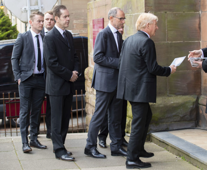 03/05/19 ST ALOYSIUS - GLASGOW Former Celtic managers Martin O'Neill (left) and Gordon Strachan arrive at the funeral of legendary European Cup winning captain Billy McNeill
