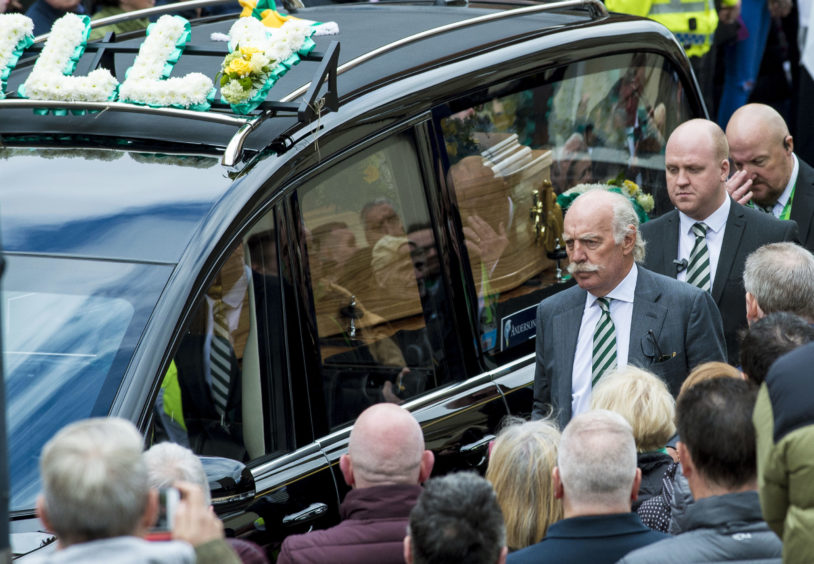 The hearse of Celtic's legendary European Cup winning captain Billy McNeill leaves St Aloysius in Glasgow following his funeral