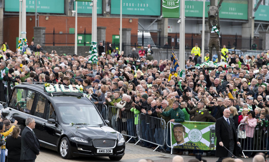 The hearse of legendary Celtic captain Billy McNeill makes its way past Celtic Park, and the Billy McNeill statue, following his funeral