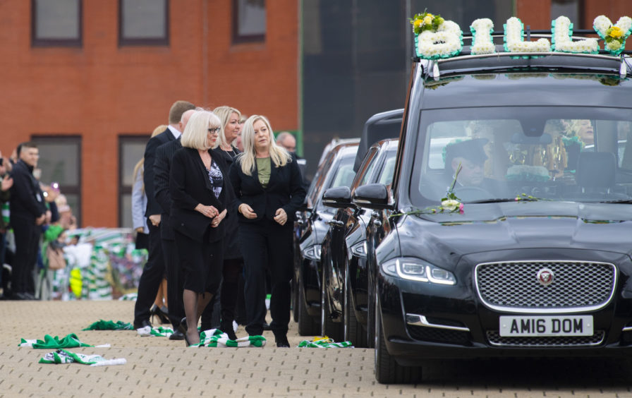 03/05/19 CELTIC PARK - GLASGOW The hearse of Celtic's legendary captain Billy McNeill makes its way past Celtic Park, following his funeral. His family walk down the Celtic Way, with his wife Liz (left) leading the way
